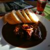 Have wild boar made with rosehip sauce in the pub frequented by B. Hrabal